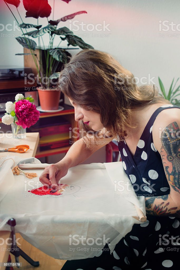 Woman embroidering stock photo