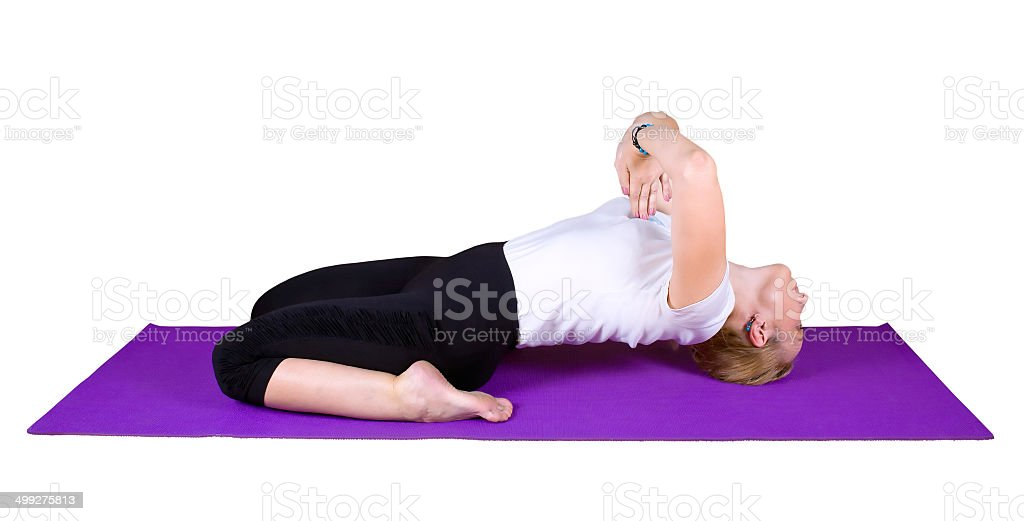 Woman engaged in yogic exercises stock photo