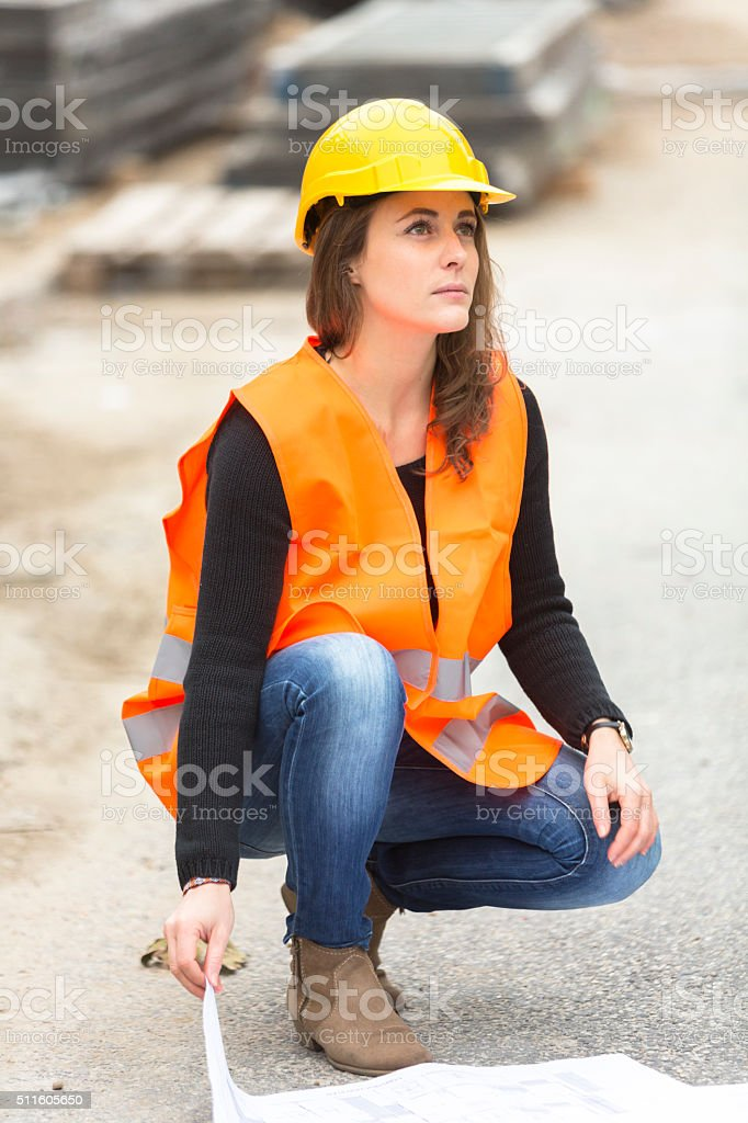 Woman engineer with safety jacket and hardhat stock photo