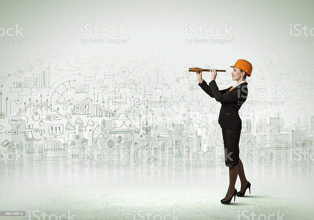 Woman engineer with scope royalty-free stock photo