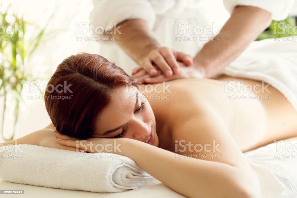 Woman enjoing massage stock photo