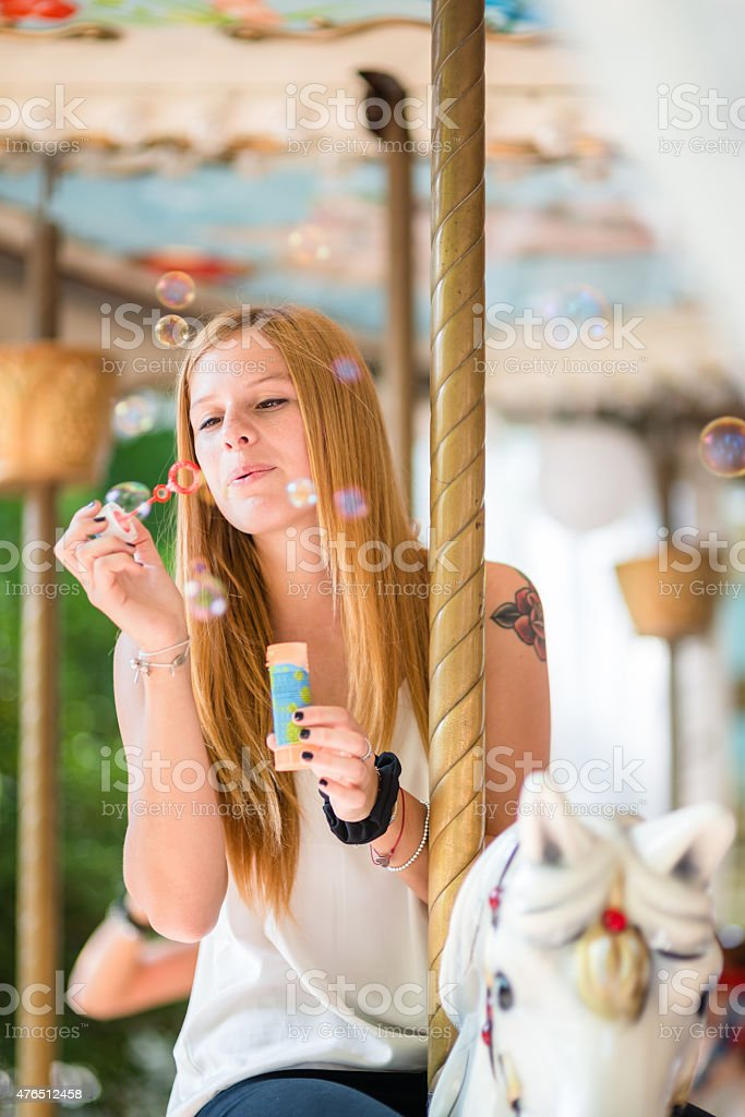 Woman enjoy on the carousel stock photo