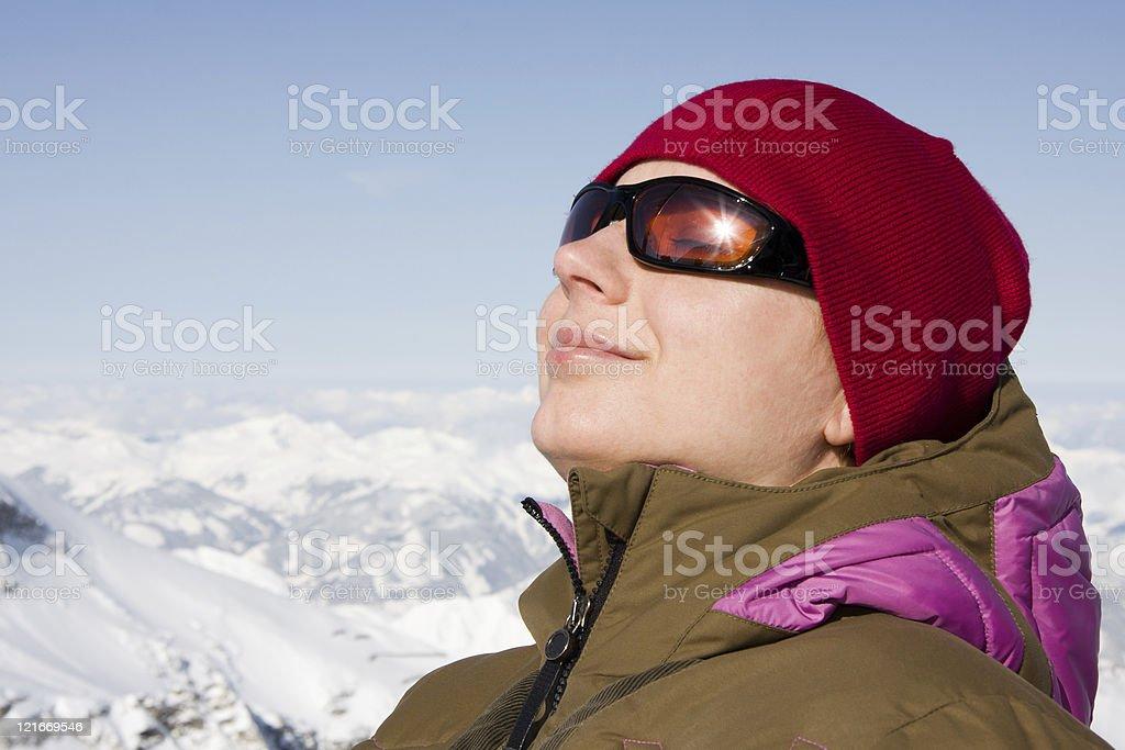 Woman enjoy sun in winter stock photo