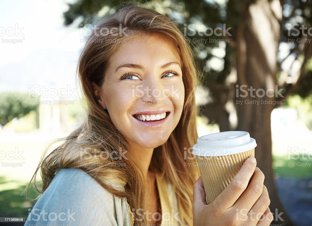 Woman enjoying a cup of coffee outdoors royalty-free stock photo