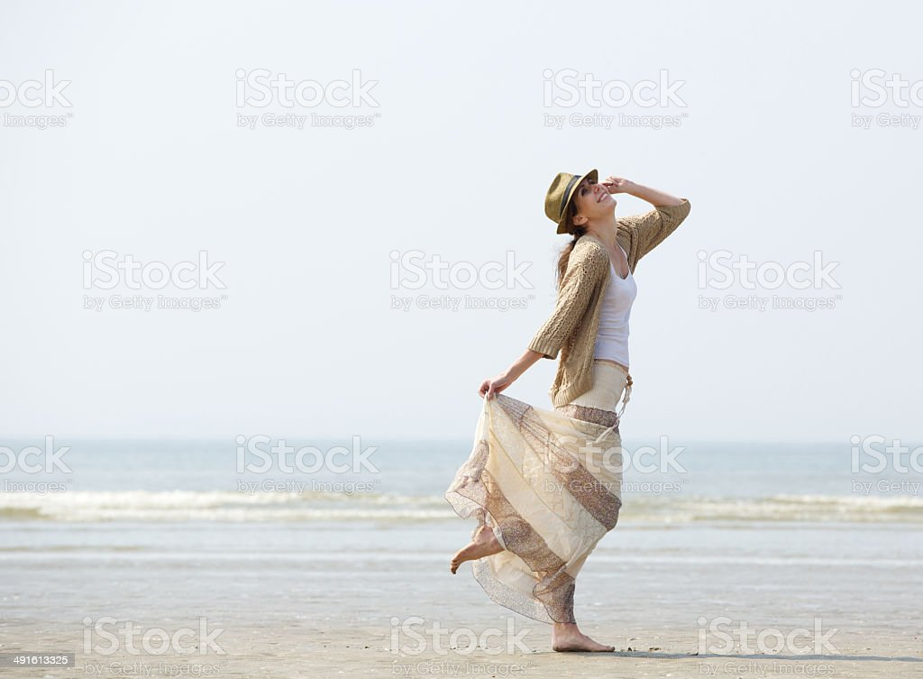 Woman enjoying a day at the beach stock photo