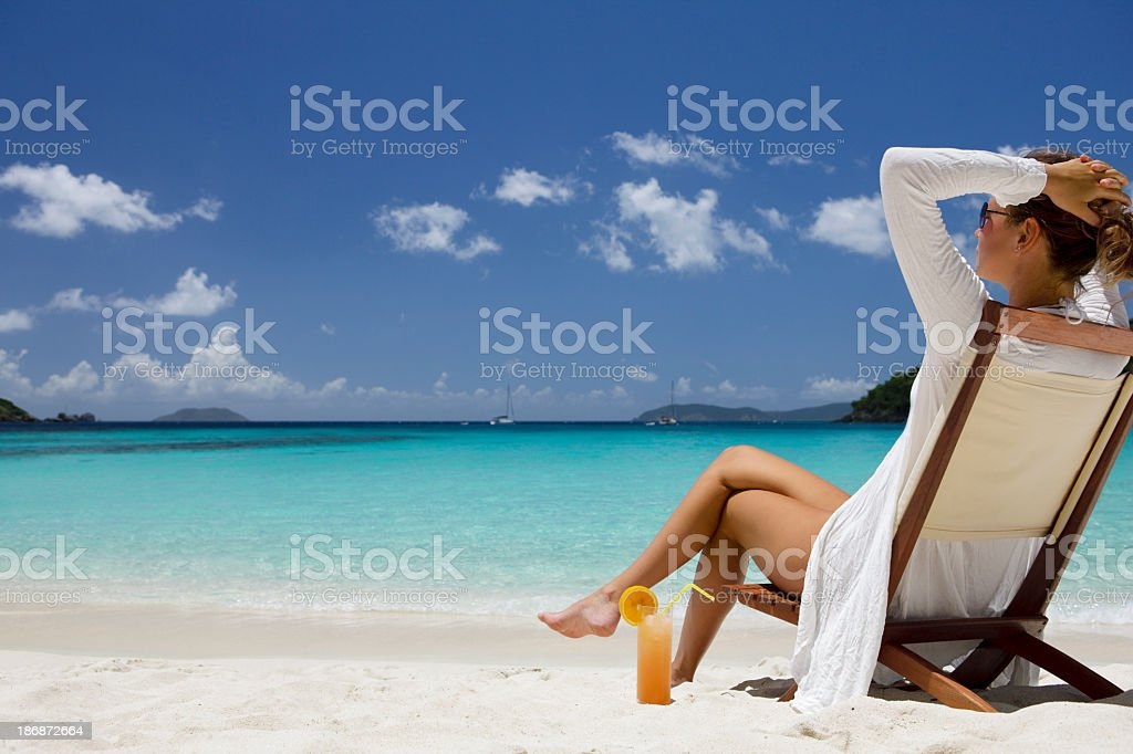 woman enjoying a day at the Caribbean beach stock photo