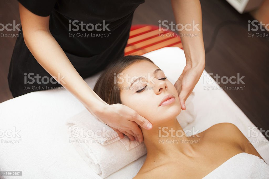 Woman enjoying a facial massage stock photo