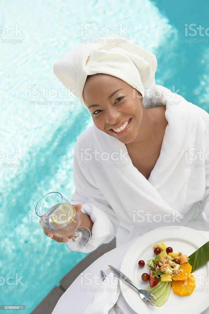 Woman Enjoying a Fresh Meal at the Spa stock photo