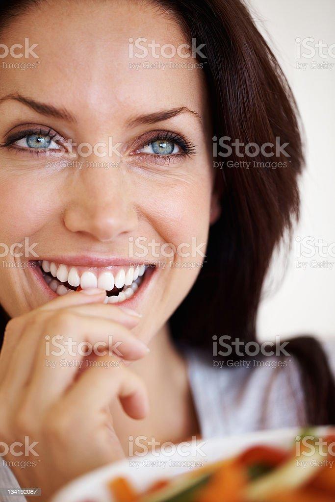 Woman enjoying a fresh salad royalty-free stock photo