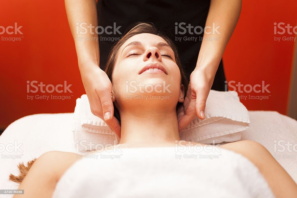 Woman enjoying a massage stock photo