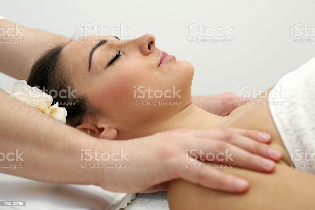 Woman enjoying a massage treatment stock photo