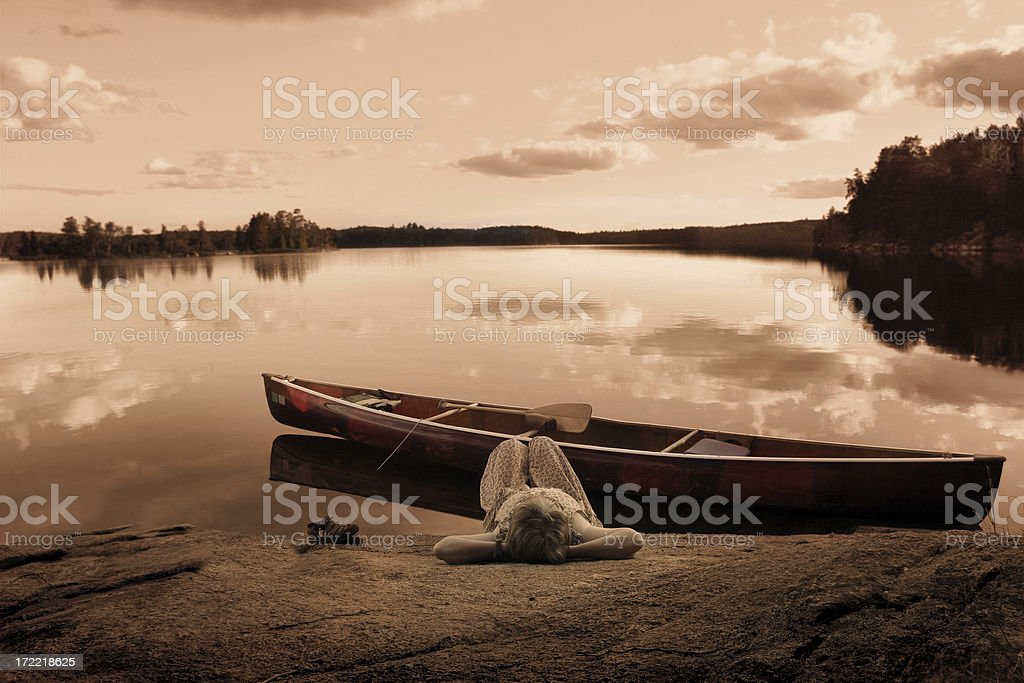 Woman enjoying a moment of serenity. (Tri Tone) stock photo