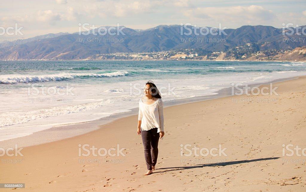 Woman enjoying a walk at Santa Monica Beach stock photo