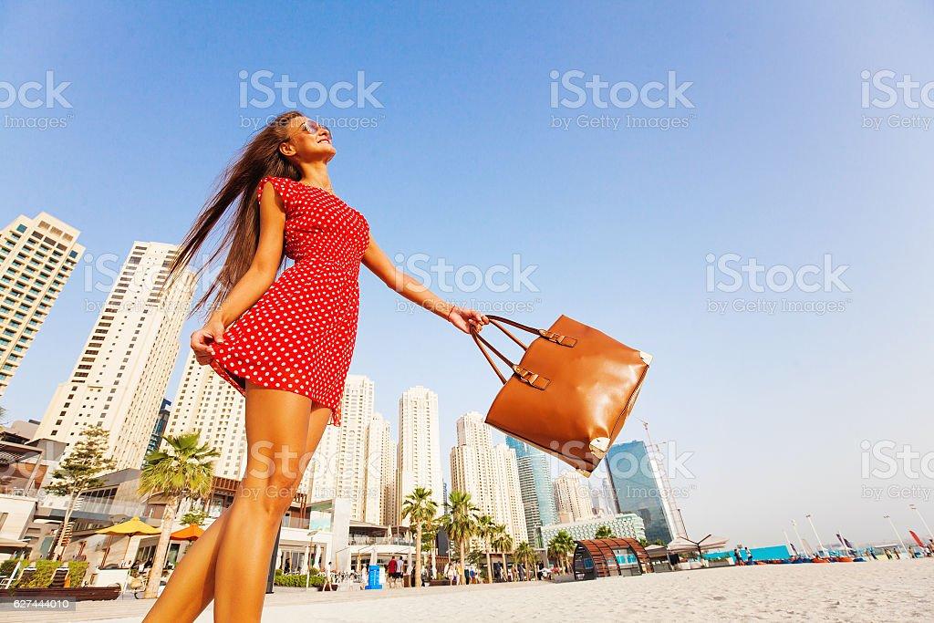 woman enjoying a walk on a beach stock photo