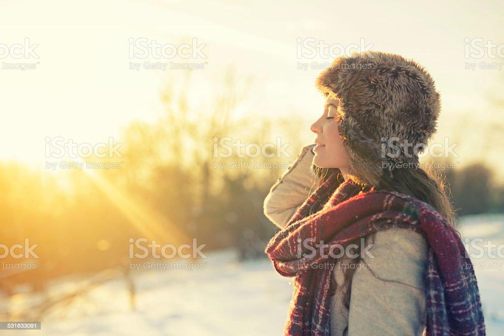 Woman enjoying a winter day on mountains stock photo