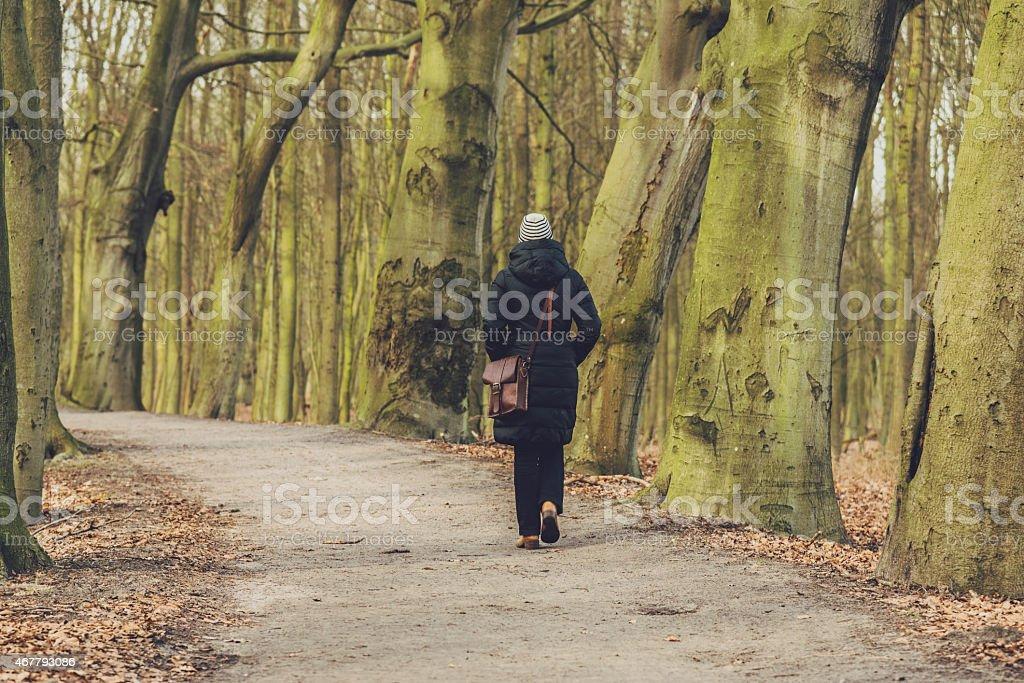 Woman enjoying a winter walk stock photo