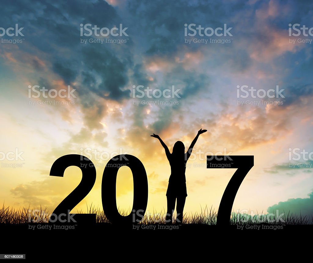 woman Enjoying and 2017 years while celebrating new year stock photo