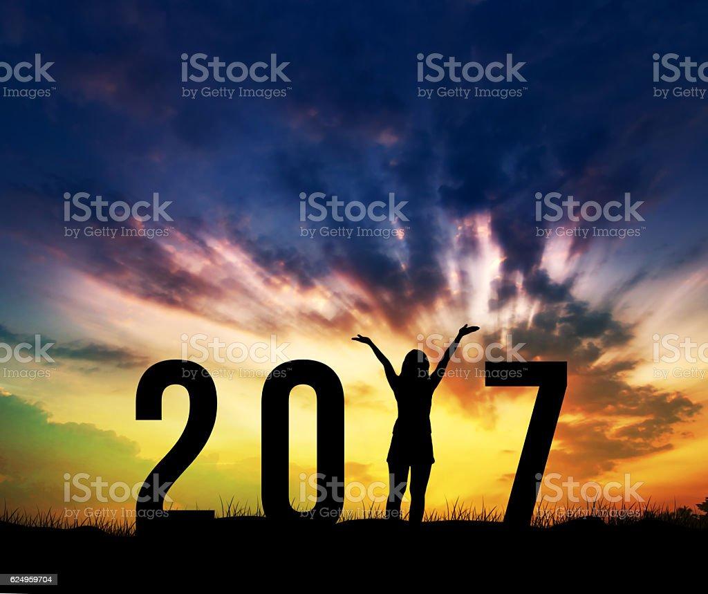 woman Enjoying and 2017 years while celebrating new year stock photo