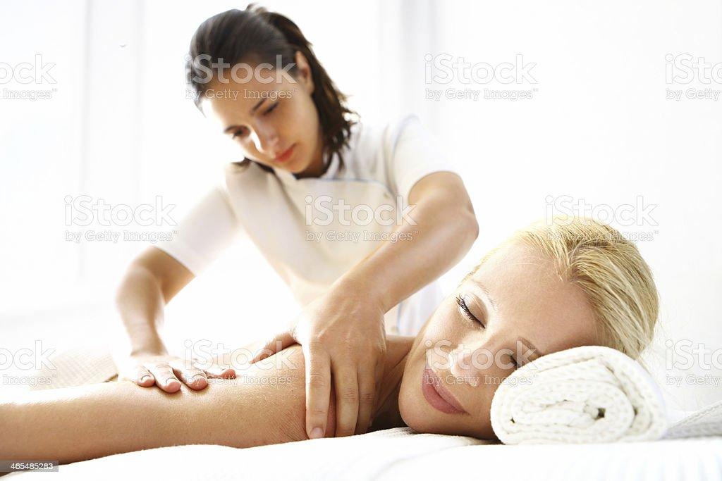 Woman enjoying back massage. stock photo