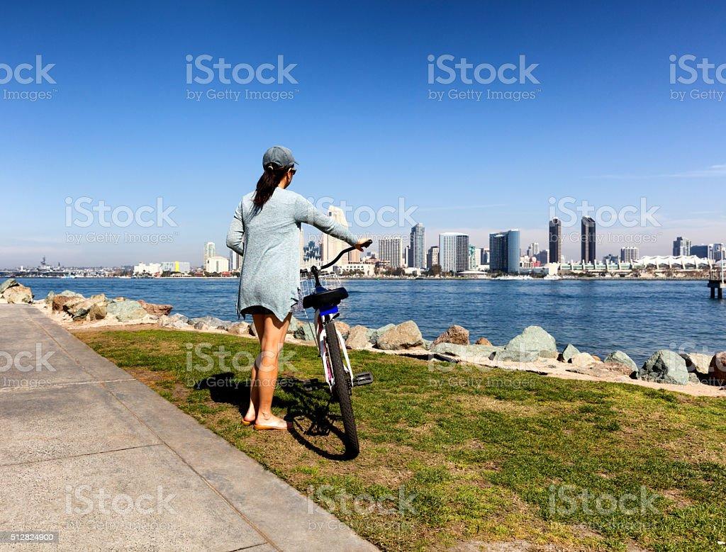 Woman enjoying biking near bay of San Diego California stock photo