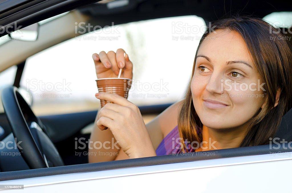 Woman enjoying coffee in her car stock photo
