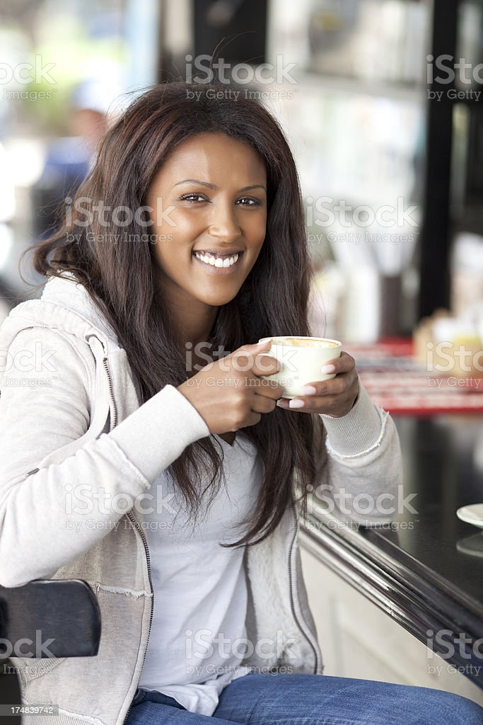 Woman enjoying coffee royalty-free stock photo