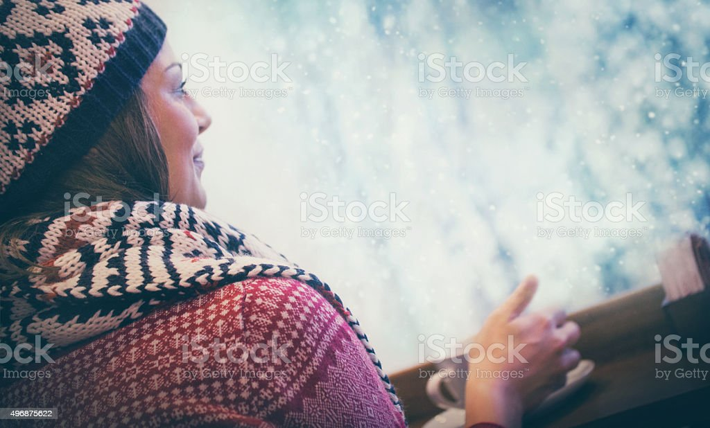 Woman enjoying cup of tea at coffee shop. stock photo