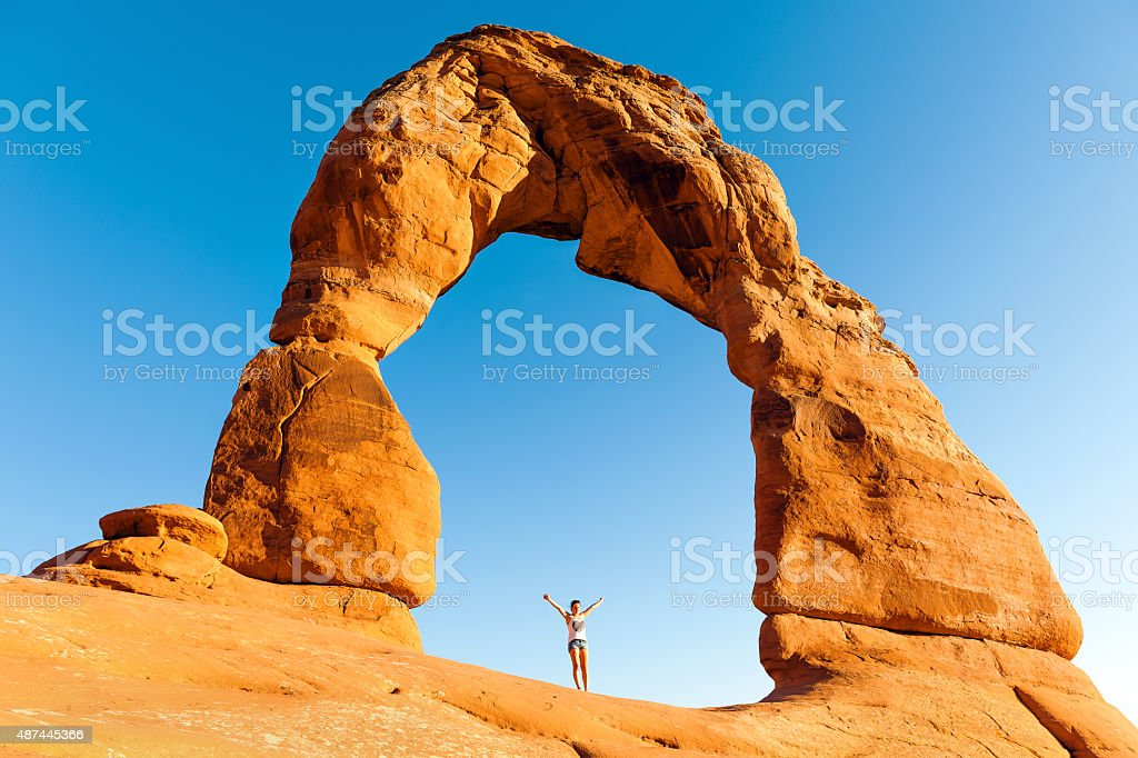 Woman Enjoying Delicate Arch in Utah USA stock photo