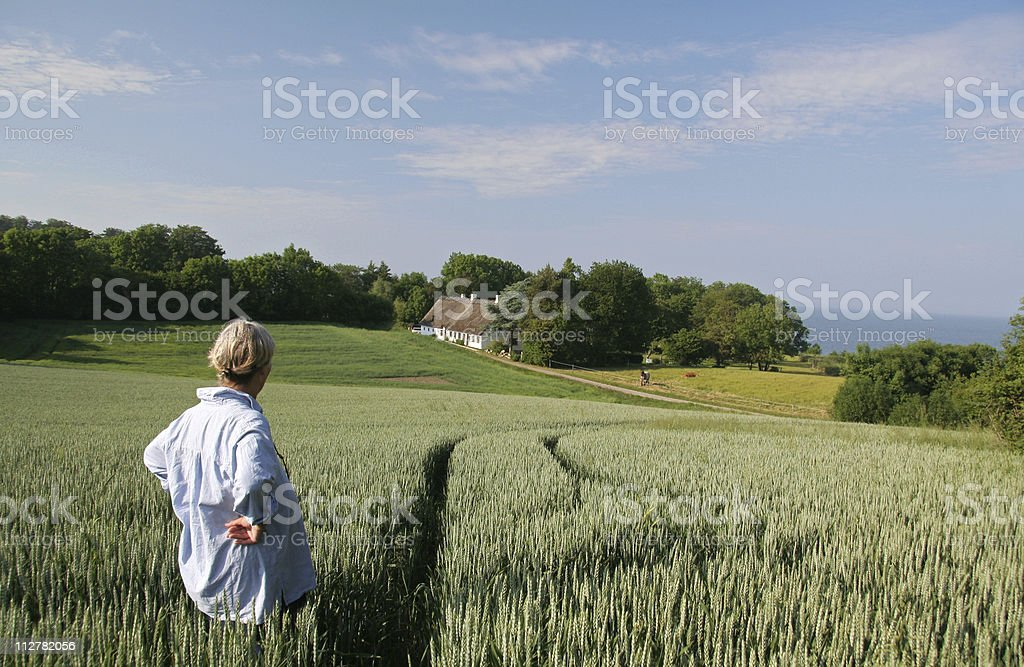 Woman enjoying her  beautiful land and house in  Denmark royalty-free stock photo