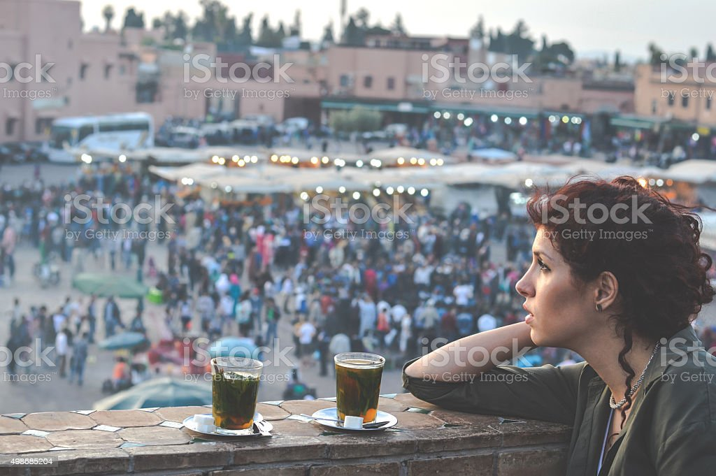 Woman enjoying in tea on balcony stock photo