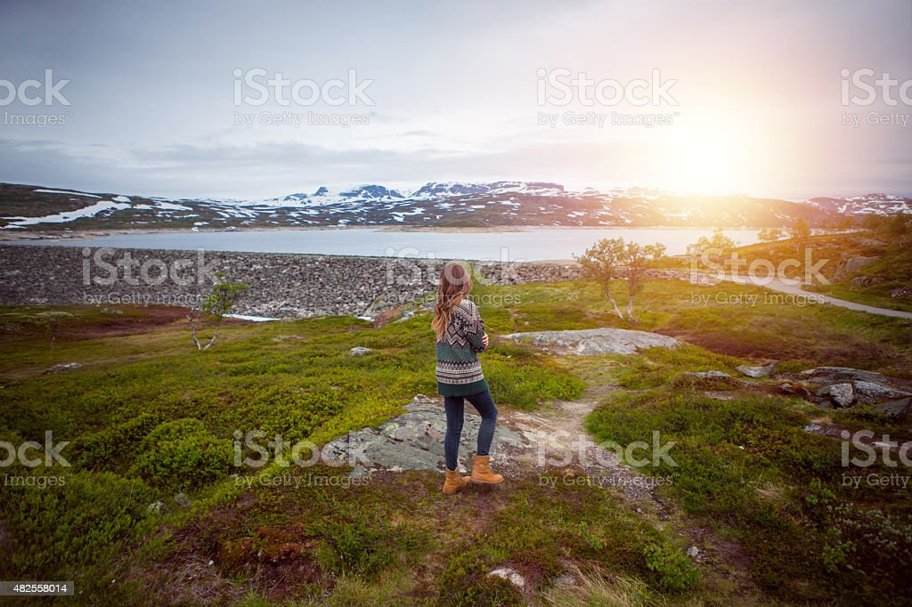 Woman enjoying landscape of national park in Norway. stock photo