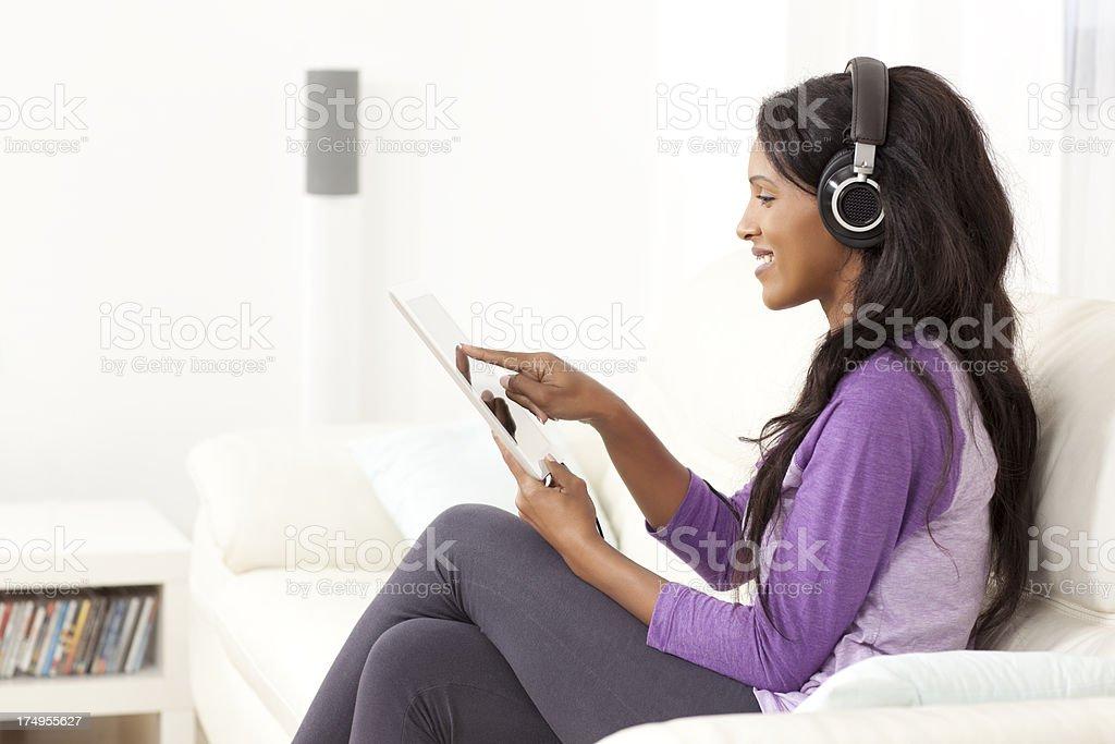 Woman enjoying music on digital tablet. royalty-free stock photo