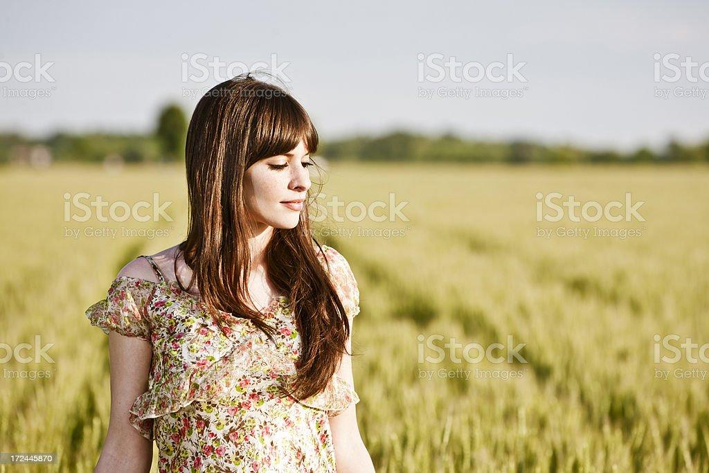 Woman enjoying nature at sunset royalty-free stock photo