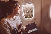 Woman enjoying Notre dame de Paris from the airplane window