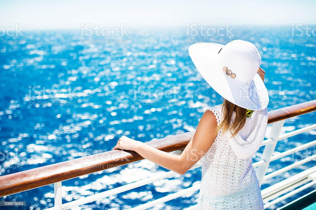 Woman enjoying on a cruise. stock photo