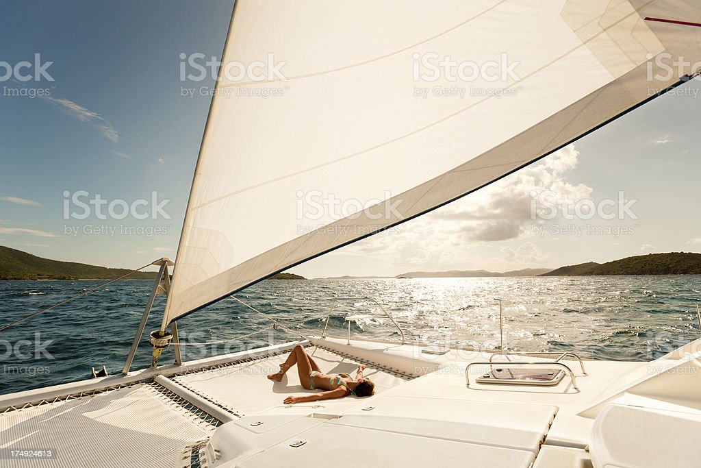 woman enjoying sailing through the Caribbean on a catamaran stock photo