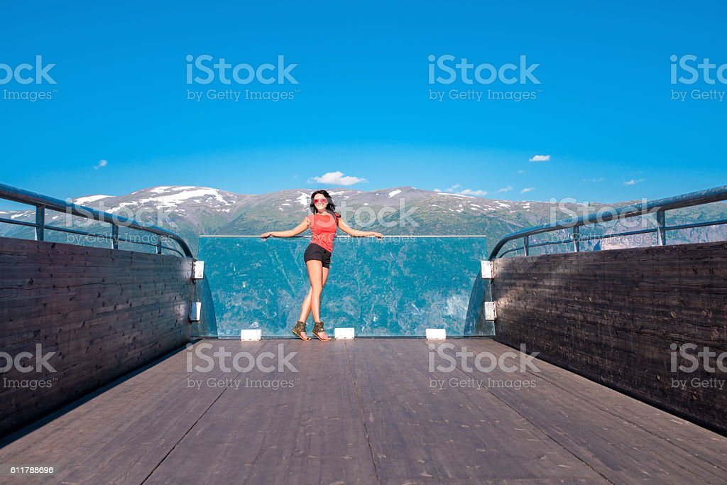 Woman enjoying scenics from Stegastein Viewpoint stock photo