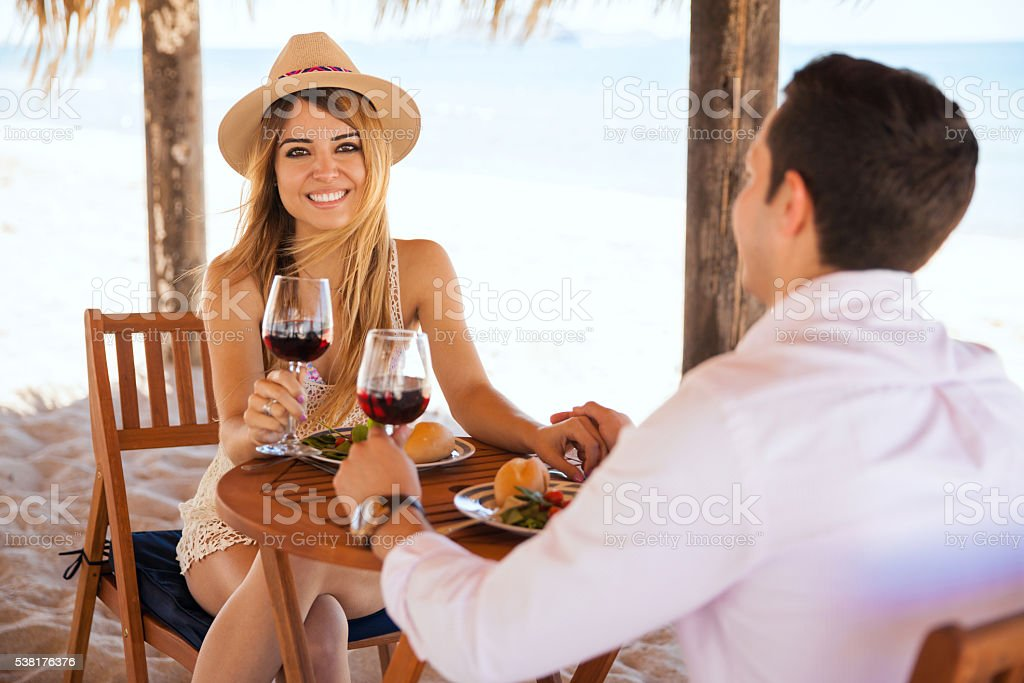 Woman enjoying some wine with her date stock photo