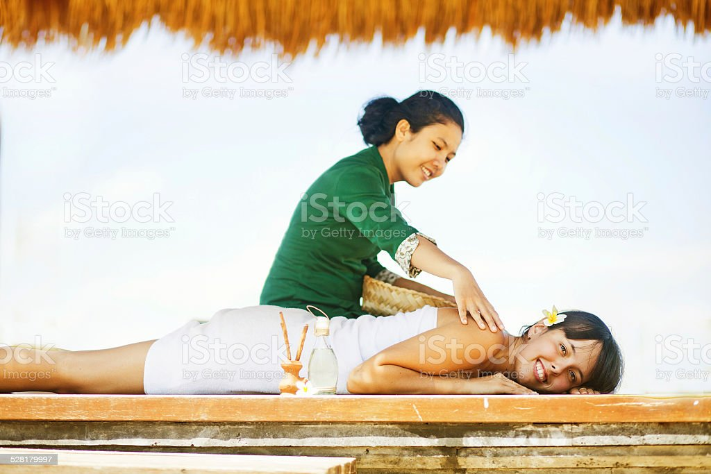 Woman enjoying spa treatment stock photo
