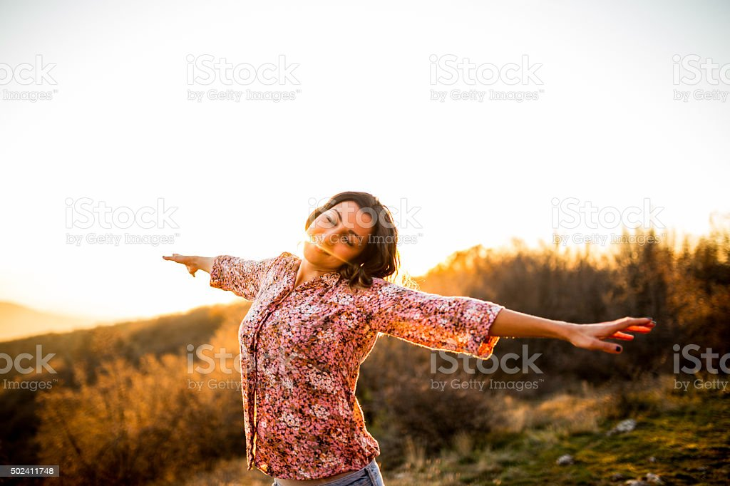 Woman enjoying sun stock photo