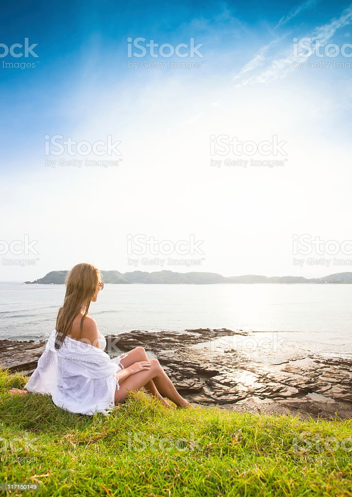 Woman enjoying sunset on the hill royalty-free stock photo