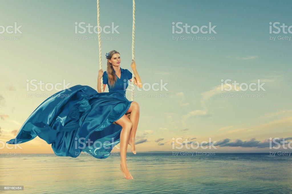 Woman enjoying swing stock photo
