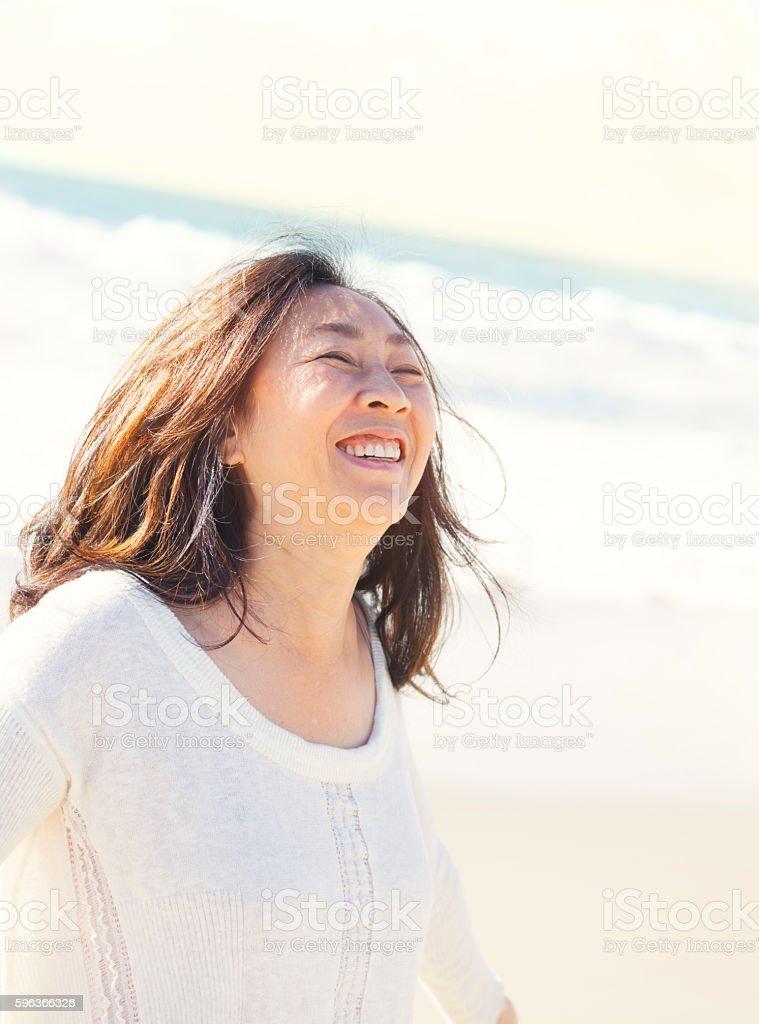 Woman enjoying the beach stock photo