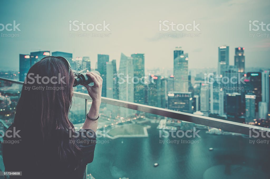 Woman Enjoying the City View on Rooftop Deck stock photo