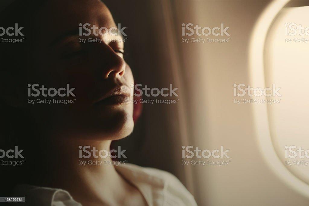 Woman enjoying the flight stock photo