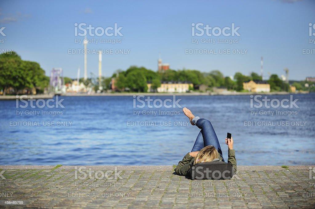 Woman enjoying the great weather stock photo