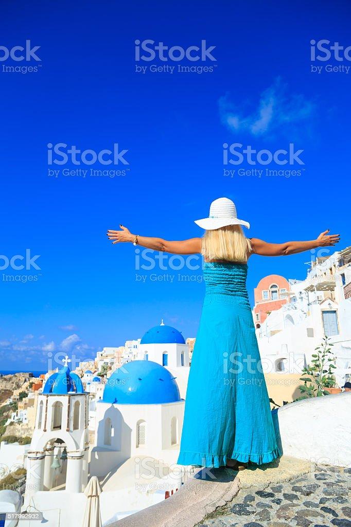 Woman enjoying the magnificent view of Santorini stock photo