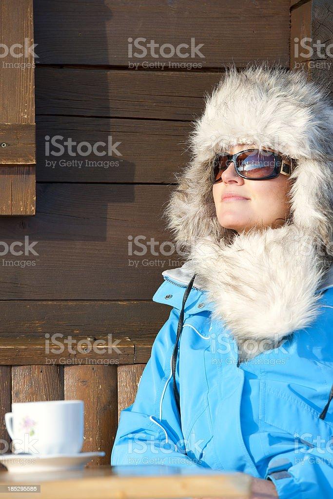 Woman enjoying the sun after skiing royalty-free stock photo
