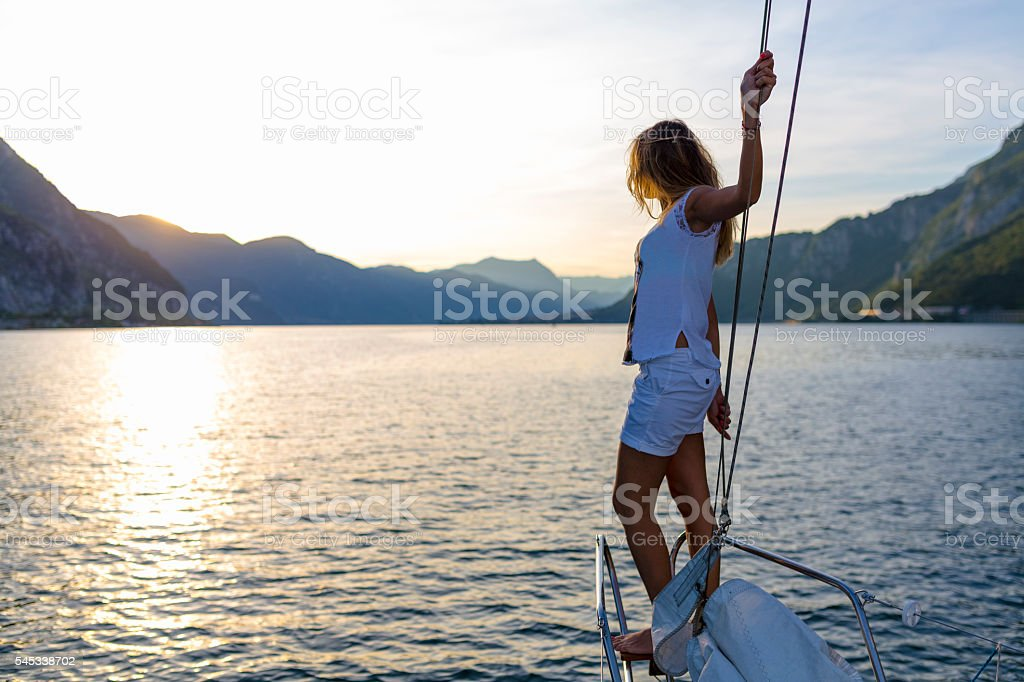 Woman enjoying the trip on a sailing boat stock photo
