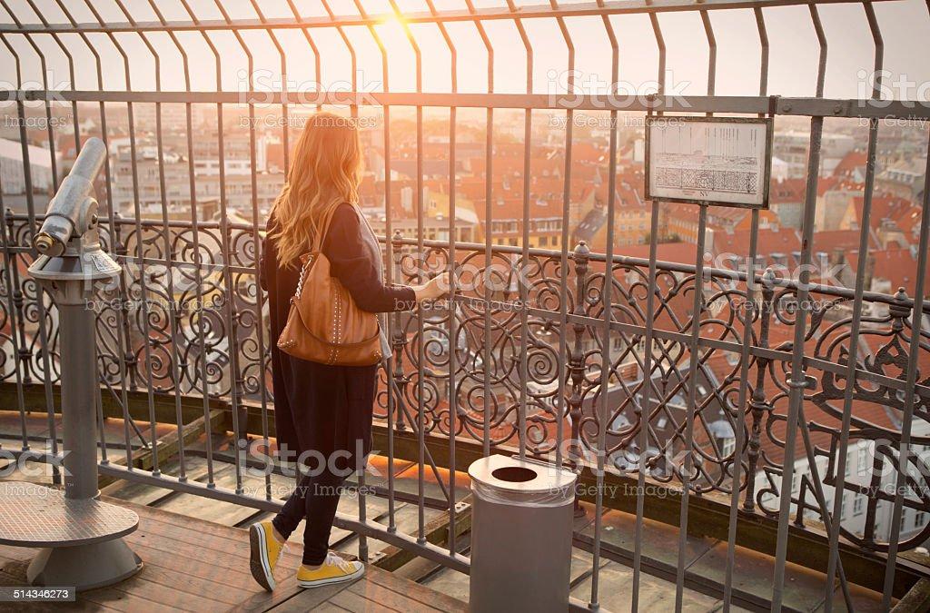 Woman enjoying the view at sunset. stock photo